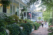 Friends take a walk down Nunn Street in Wilmington, NC where the architecture of front porches adorn each house along the way.  PHOTO BY:  JEFF JANOWSKI PHOTOGRAPHY