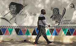 South Africa - Pretoria - 25 May 2020 - On Africa Day a man walks past a mural depicting music legends Lucky Dube and Yvonne Chakachaka at the Kara Heritage centre, Madiba street.<br />Picture: Jacques Naude/African News Agency(ANA)