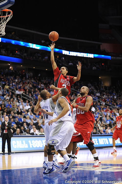Jan 29, 2009; Newark, NJ, USA; Rutgers guard Mike Rosario (3) puts up a shot over Seton Hall guard Jordan Theodore (10) and guard Keon Lawrence (2) during the second half of Seton Hall's 70-67 victory at the Prudential Center.