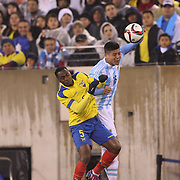 Alex Ibarra, (left), Ecuador and Marcos Rojo, Argentina, challenge for the ball during the Argentina Vs Ecuador International friendly football match at MetLife Stadium, New Jersey. USA. 31st march 2015. Photo Tim Clayton