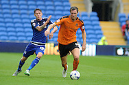 Kevin McDonald  of Wolverhampton Wanderers ® breaks away from Joe Mason of Cardiff city. .Skybet football league championship match, Cardiff city v Wolverhampton Wanderers at the Cardiff city stadium in Cardiff, South Wales on Saturday 22nd August 2015.<br /> pic by Andrew Orchard, Andrew Orchard sports photography.