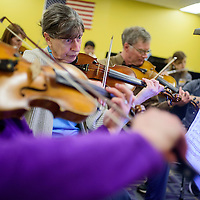 Violinist Esther Koops, center, and thereat of the Red Rock String Ensemble rehearse Sunday at Miyamura High School in Gallup.