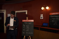 """© London News Pictures. """"Looking for Nigel"""". A body of work by photographer Mary Turner, studying UKIP leader Nigel Farage and his followers throughout the 2015 election campaign. PICTURE SHOWS - The election odds are written up on blackboards at the UKIP Spring Conference at the Winter Gardens theatre in Margate, Kent, on February 27th 2015. Photograph by Mary Turner . Photo credit: Mary Turner/LNP **PLEASE CALL TO ARRANGE FEE** **More images available on request**"""
