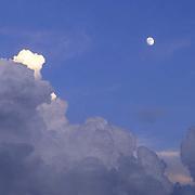 Massive thunderhead cloud and rising moon. Evening. Montana.