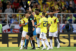 Referee Mark Geiger shows a yellow card to Colombia's Radamel Falcao (left) as his team mates protest during the FIFA World Cup 2018, round of 16 match at the Spartak Stadium, Moscow.
