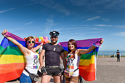 Colourful participants prepare to march in the Kent Pride celebrations in the seaside town of Margate.