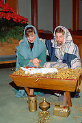 Mary and Joseph age 16 tending baby Jesus at Christmas Pageant.  WesternSprings Illinois USA