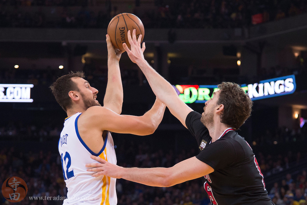 November 20, 2015; Oakland, CA, USA; Golden State Warriors center Andrew Bogut (12) shoots the basketball against Chicago Bulls center Pau Gasol (16) during the second quarter at Oracle Arena.
