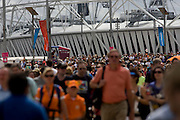 Tens of thousands of spectators stretching back towards the main stadium in the Olympic Park during the London 2012 Olympics. This land was transformed to become a 2.5 Sq Km sporting complex, once industrial businesses and now the venue of eight venues including the main arena, Aquatics Centre and Velodrome plus the athletes' Olympic Village. After the Olympics, the park is to be known as Queen Elizabeth Olympic Park.
