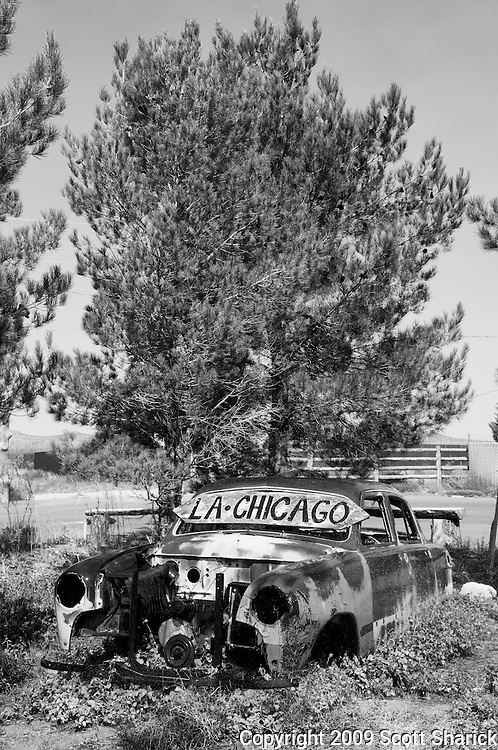 A sign giving the start and end points of Route 66 - LA and Chicago. Missoula Photographer