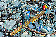 Plastic detritis and debris litter the rocks on a beach, County Clare, West Coast of Ireland