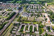 Nederland, Zuid-Holland, Rotterdam, 15-07-2012; Links Pendrecht, rechts van de Zuiderparkweg Zuidwijk (deelgemeente Charlois, Rotterdam-Zuid). Metrostation Slinge..Nieuwbouwwijk uit de jaren vijftig van de vorige eeuw, wederopbouw periode. Stedenbouwkundig ontwerp van Lotte Stam-Beese, kenmerkend zijn de ruime opzet en  veel groen. Ontworpen als wijk met verschillende woningtypen (en verschillende bewoners) en voorzien van alle voorzieningen..Pendrecht (part of Charlois, Rotterdam-South). New neighborhood (fifties of the last century), post-war reconstruction period. Urban design of Lotte Stam-Beese, characterized by spacious layout and lots of green. Designed as residential district with different housing types.. .QQQ.luchtfoto (toeslag), aerial photo (additional fee required).foto/photo Siebe Swart