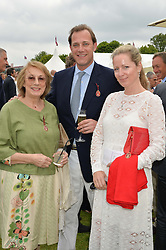 Left to right, NINA CAMPBELL, her son MAX KONIG and his wife JULIET FETHERSTONHAUGH at the Cartier Queen's Cup Polo final at Guard's Polo Club, Smiths Lawn, Windsor Great Park, Egham, Surrey on 14th June 2015