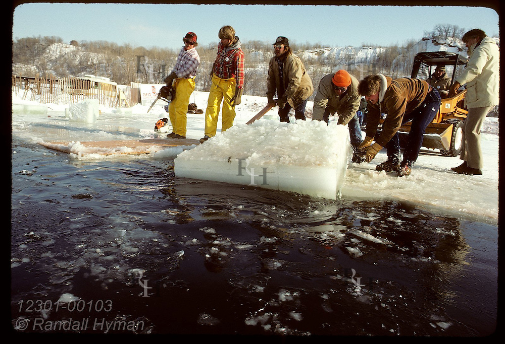 Men pull an ice block from Pickerel Lake for use as ice sculpture pedestals;St Paul Wintr Carnival Minnesota