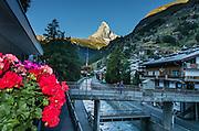 Sunrise on the Matterhorn, seen from Zermatt, Pennine Alps, Switzerland, Europe. Flowing through town is the Matter Vispa, a river tributary of the Rhone.