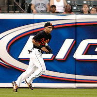 24 August 2007:  Baltimore Orioles left fielder Jay Payton (16) makes a juggling catch of a line drive in the 3rd inning on a ball hit by Minnesota Twins third baseman Nick Punto.  The Twins defeated the Orioles 7-4 at Camden Yards in Baltimore, MD.   ****For Editorial Use Only****
