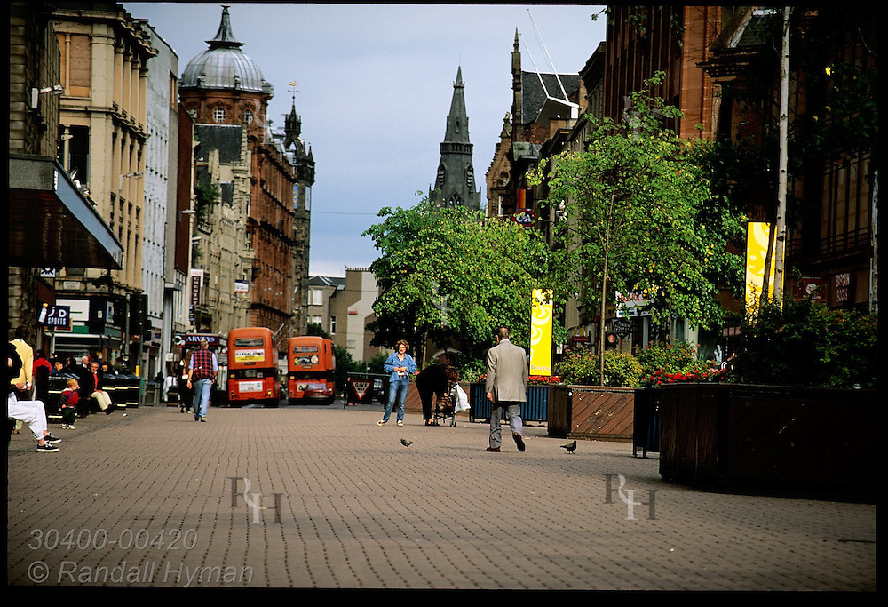 Shoppers walk along the outdoor mall area of Buchanan Street on a July evening; Glasgow. Scotland