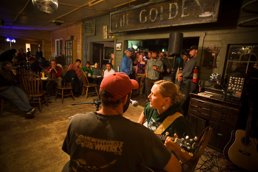 Mountain guide Nathan Rice and Wrangell Mountain Center staff Shawn Olson play together at the weekly Thursday open-mic night at The New Golden Saloon in McCarthy, Alaska.