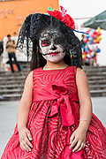 A young Mexican girl dressed in La Calavera Catrina costume for the Day of the Dead or Día de Muertos festival October 29, 2017 in San Miguel de Allende, Guanajuato, Mexico. The festival has been celebrated since the Aztec empire celebrates ancestors and deceased loved ones.