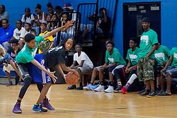 Shania Liburd keeps the ball away from Jovani Marrishow.  Milton M. Newton Summer Classic Basketball Single Elimination 13-16 CoEd Tournament at the Charlotte Amalie High School Gymnasium.  St. Thomas, USVI.  8 August 2016.  © Aisha-Zakiya Boyd