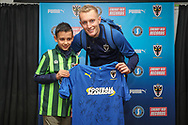 AFC Wimbledon striker Joe Pigott (39) poses with Mascot and signed shirt during the The FA Cup match between AFC Wimbledon and Doncaster Rovers at the Cherry Red Records Stadium, Kingston, England on 9 November 2019.