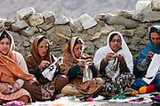 Women sew together in mountain village of Altit in Hunza region of Karokoram Mountains, Pakistan