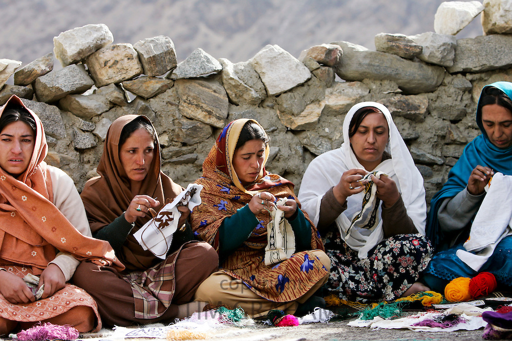 Women sew together in mountain village of Altit in Hunza region of Karokoram Mountains, Pakistan