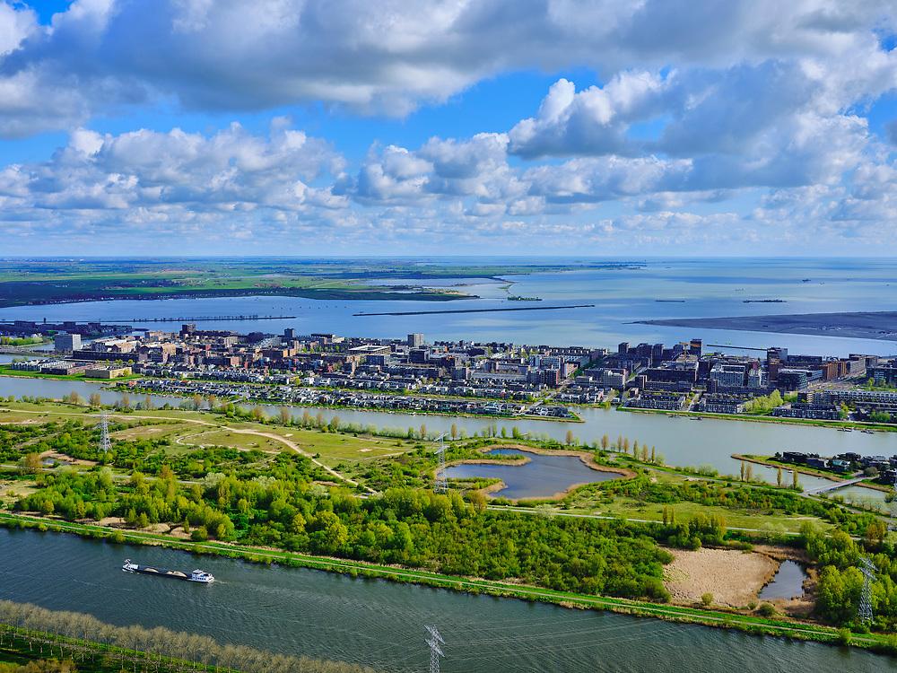 Nederland, Noord-Holland, Amsterdam, 07-05-2021; IJburg gezien vanuit Diemen-Noord. Vuilstortplaats Diemerzeedijk nu Diemerpark in de voorgrond.<br /> IJburg seen from Diemen-Noord. Garbage dump Diemerzeedijk now Diemerpark in the foreground.<br /> luchtfoto (toeslag op standaard tarieven);<br /> aerial photo (additional fee required)<br /> copyright © 2021 foto/photo Siebe Swart