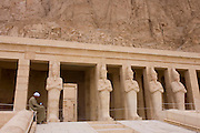 "Portrait of a local guide near the colossi of Pharaohs at the ancient Egyptian Temple of Hatshepsut near the Valley of the Kings, Luxor, Nile Valley, Egypt. The Mortuary Temple of Queen Hatshepsut, the Djeser-Djeseru, is located beneath cliffs at Deir el Bahari (""the Northern Monastery""). The mortuary temple is dedicated to the sun god Amon-Ra and is considered one of the ""incomparable monuments of ancient Egypt."" The temple was the site of the massacre of 62 people, mostly tourists, by Islamists on 17 November 1997."