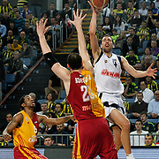 Fenerbahce Ulker's Roko Leni UKIC (R) and Galatasaray Cafe Crown's Jerry JOHNSON (L) during their Turkish Basketball league derby match  Fenerbahce Ulker between Galatasaray Cafe Crown at Sinan Erdem Arena in Istanbul, Turkey, Wednesday, April 20, 2011. Photo by TURKPIX