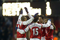 20/11/2004 - FA Barclays Premiership - Arsenal v  - West Bromich Albion - HIghbury Stadium, London<br />Arsenal's goalscorer Robert Pires (2nd right) celebrates with team mates Ashley Cole (right), Thierry Henry and Francesc Fabregas.<br />Photo:Jed Leicester/Back Page Images