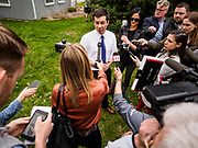 "17 APRIL 2019 - MARSHALLTOWN, IOWA:  Mayor PETE BUTTIGIEG answers reporters' questions after a meet and greet at home in Marshalltown, Iowa. ""Mayor Pete,"" as he goes by, declared his candidacy to be the Democratic nominee for the US Presidency on April 14. Buttigieg is touring Iowa this week. Iowa traditionally hosts the the first selection event of the presidential election cycle. The Iowa Caucuses will be on Feb. 3, 2020.                PHOTO BY JACK KURTZ"