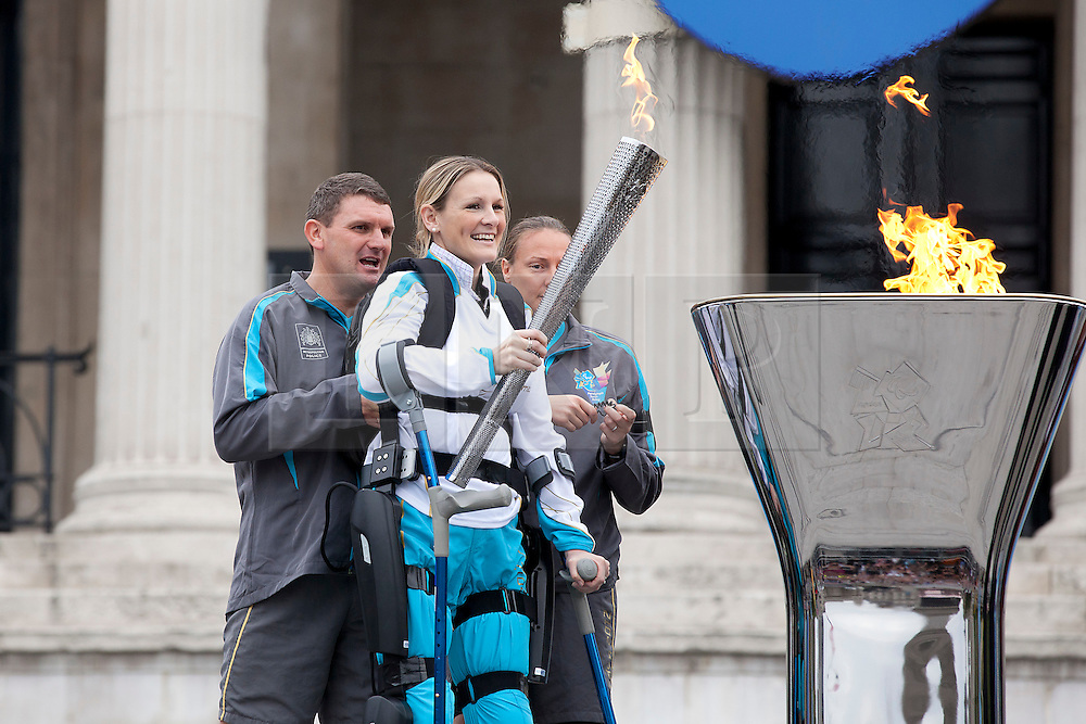 © Licensed to London News Pictures. 24/08/2012. LONDON, UK. Claire Lomas smiles after lighting the Paralympic Cauldron in Trafalgar Square today (24/08/12). Ms Lomas, formerly a horse event rider, was paralysed from the chest down after being injured during the Osberton Horse Trials and completed the London Marathon in 2012. Photo credit: Matt Cetti-Roberts/LNP