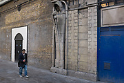 Ghostly figure looms over passers by at the now closed old London Dungeon, UK.