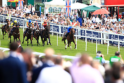 G K Chesterton ridden by jockey William Buick (right) on the way to winning the Investec Click & Invest Mile Handicap on Ladies Day during the 2017 Investec Epsom Derby Festival at Epsom Racecourse, Epsom.