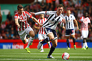 Marco van Ginkel of Stoke City pulls the shirt of Craig Gardner of West Bromwich Albion. Barclays Premier League match, Stoke city v West Bromwich Albion at the Britannia stadium in Stoke on Trent, Staffs on Saturday 29th August 2015.<br /> pic by Chris Stading, Andrew Orchard sports photography.