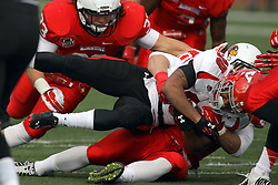 08 November 2014: Alex Donnelly brings down Jody Webb during an NCAA Missouri Valley Football Conference game between the Youngstown State Penguins and the Illinois State Redbirds at Hancock Stadium in Normal Illinois