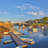 Perkins Cove sunset scenery of the iconic wodden drawbridge, fishing boats and rowboats in Ogunquiet, Maine, starting point for the beautiful and picturesque Marginal Way.<br /> <br /> Perkins Cove Ogunquit Maine Harbor Scenery photography image artworks are available as museum quality photography prints, canvas prints, acrylic prints, wood prints or metal prints. Prints may be framed and matted to the individual liking and decorating needs.<br /> <br /> Good light and happy photo making!<br /> <br /> My best,<br /> <br /> Juergen