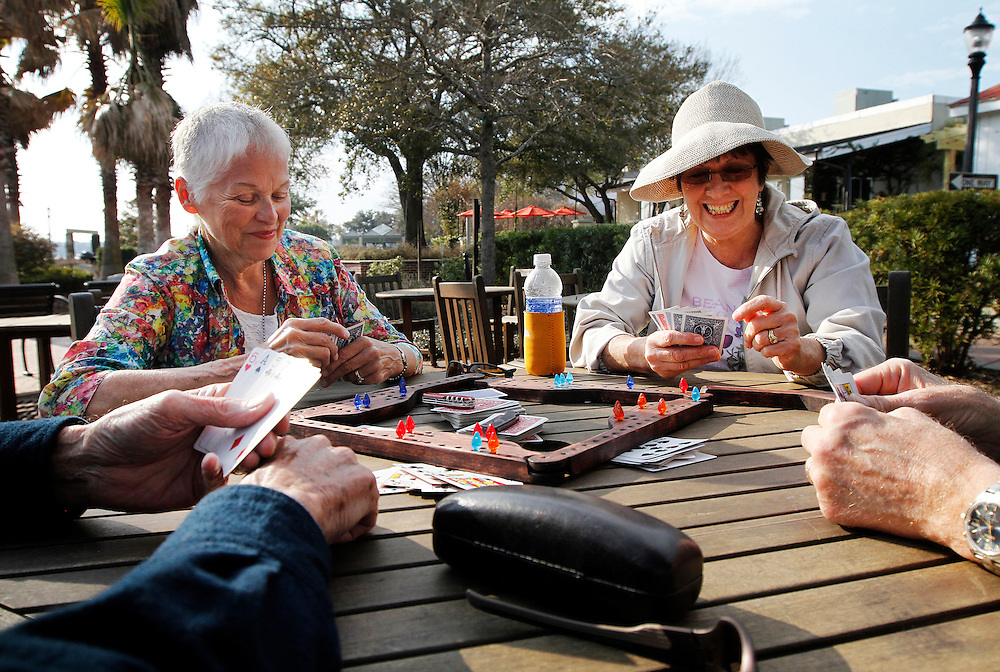"Jim Irvin, of Greensboro, N.C., Ginny Irvin, of Greensboro, N.C., Libbie Holt, of Baltimore, and Jack Holt, of Baltimore, enjoy a game of Pegs and Jokers while at a table in Henry C. Chambers Waterfront Park on February 25, 2014.  ""We came down here for the winter... we're full time RV'ers,"" said Mr. Irvin."
