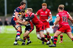 Luke Morahan of Bristol Rugby is tackled by Scott van Breda (capt) of Jersey Reds - Rogan/JMP - 28/10/2017 - RUGBY UNION - Stade Santander International - St Peter, Jersey - Jersey Reds v Bristol Rugby - Greene King IPA Championship.