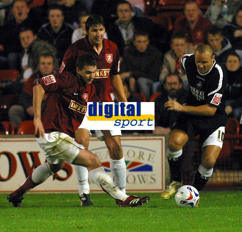 Photo: Dave Linney.<br />Walsall v Swansea City. Johnstone's Paint Trophy. 17/10/2006 Swansea's Lee Trundle(R) heads goalwards past  Anthony Gerrard