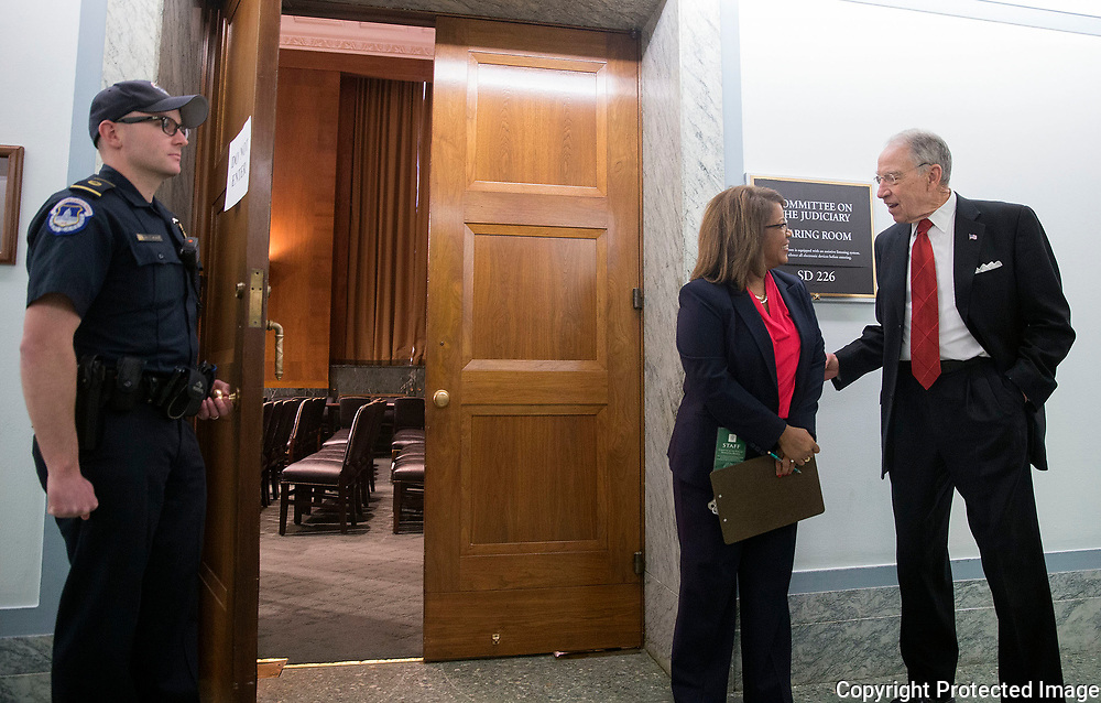 Sen. Chuck Grassley (right) talks with Roslyne Turner, Chief Clerk for the Senate Judiciary Committee, before entering a closed hearing of the Senate Judiciary Committee during the third day of testimony for Neil Gorsuch to become an Associate Justice of the US Supreme Court in the Hart Senate Office Building in Washington, D.C. on Wednesday, Mar. 22, 2017. One closed hearing with Senate Judiciary Committee members and the nominee is tradition for a Supreme Court nomination hearing.