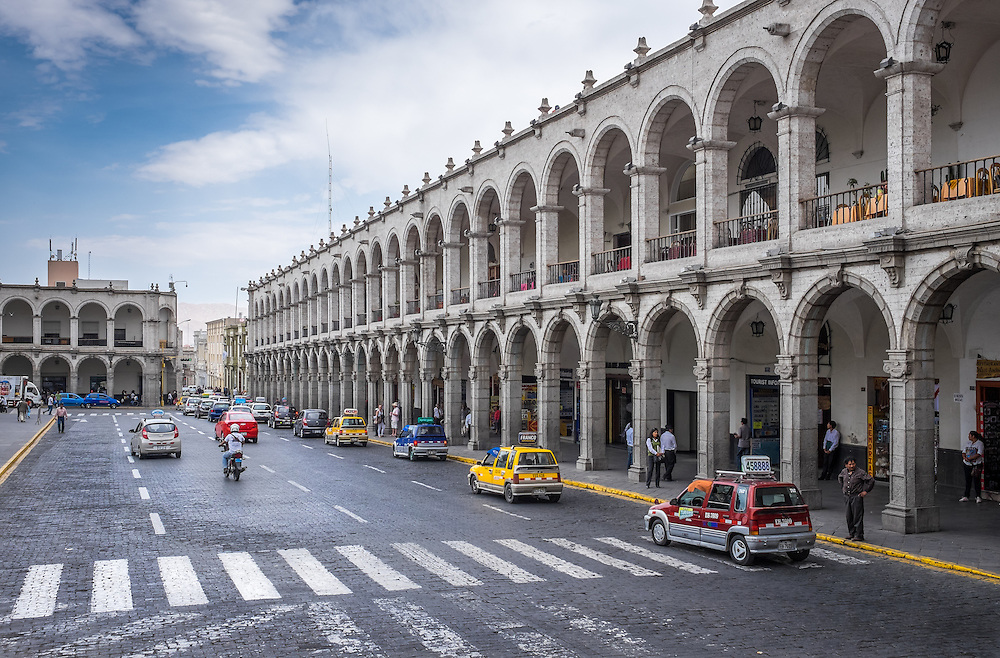 AREQUIPA, PERU - CIRCA APRIL 2014: View of typical colonnade buildings around the main square, Plaza de Armas, in Arequipa. Arequipa is the Second city of Perú by population with 861,145 inhabitants and is the second most industrialized and commercial city of Peru.