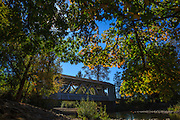 USA, Oregon, Scio, the Larwood Bridge, covered bridge over Crabtree Creek in early Autumn, from Larwood Wayside.