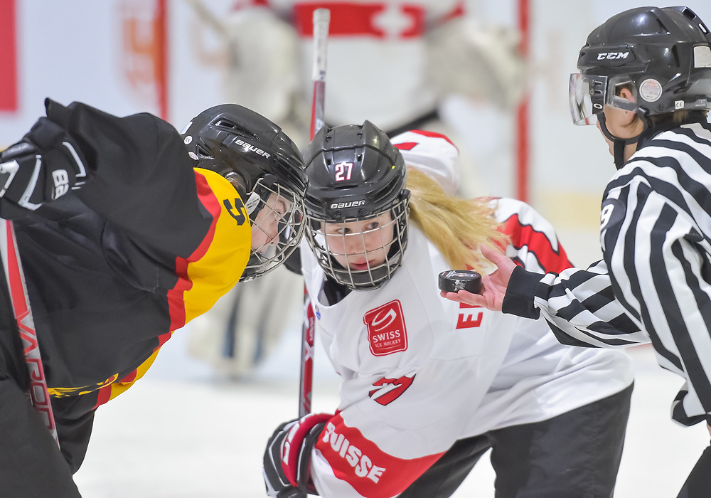 DMITROV, RUSSIA - JANUARY 12: Switzerland's Oona Emmenegger #27 faces-off against Germany's Naemi Bar #5 during relegation round action at the 2018 IIHF Ice Hockey U18 Women's World Championship. (Photo by Steve Kingsman/HHOF-IIHF Images)