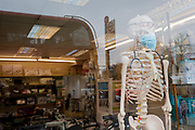 As the Coronovirus pandemic takes hold across the UK, with 53 cases now reported by health authorities, the window of a medical equipment business in south London, displays a surgical masks attached to a skeleton mannequin, on 4th March 2020, in London, England.