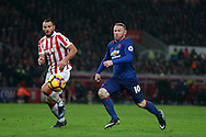 Wayne Rooney of Manchester Utd goes past Erik Pieters of Stoke city.  Premier league match, Stoke City v Manchester Utd at the Bet365 Stadium in Stoke on Trent, Staffs on Saturday 21st January 2017.<br /> pic by Andrew Orchard, Andrew Orchard sports photography.