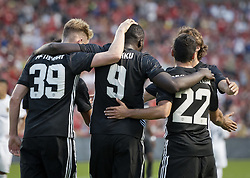 July 17, 2017 - Sandy, Utah, United States - Manchester United forward ROMELU LUKAKU (9) celebrates his first ever goal for the Red Devils with teammates SCOTT MCTOMINAY (39) and midfielder HENRIKH MKHITARYAN (22) during their friendly match at Rio Tinto Stadium in Sandy, Utah, USA on Monday, July 17, 2017. (Credit Image: © Michael Mangum via ZUMA Wire)