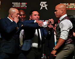 September 14, 2018 - Las Vegas, Nevada, U.S. - Oscar De La Hoya tries to keep the pease between (L-R), CHUCK LIDDELL and TITO ORTIZ during presser and weight in in Las Vegas. (Credit Image: © Gene Blevins/ZUMA Wire)