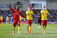 Watford Odion Jude Ighalo celebrates with team mates during the Sky Bet Championship match between Brighton and Hove Albion and Watford at the American Express Community Stadium, Brighton and Hove, England on 25 April 2015. Photo by Phil Duncan.